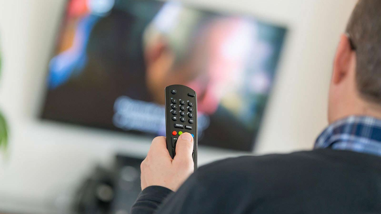 Man watching Pay TV channel