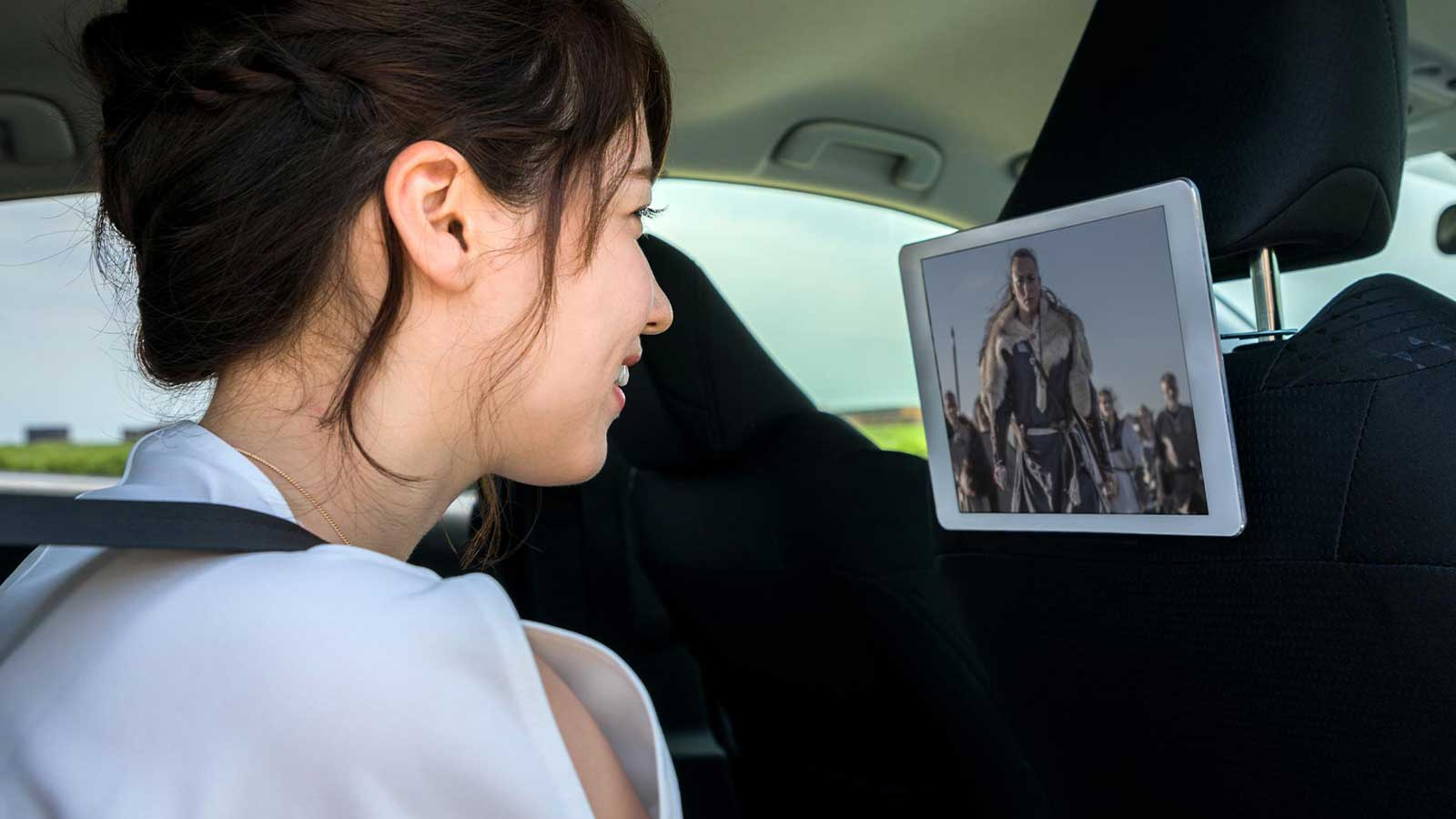 Woman watching video in vehicle entertainment system