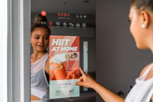 Woman using smart fitness equipment