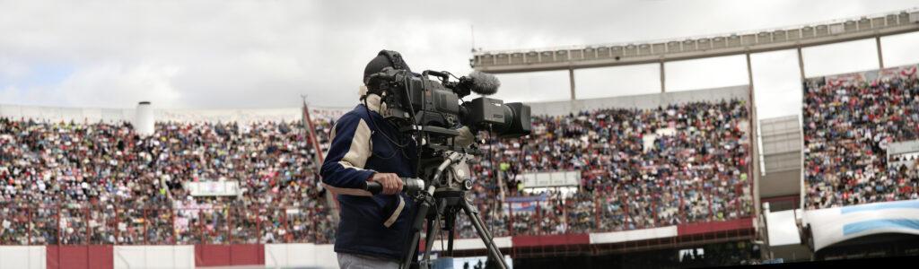 camera man filming sports event