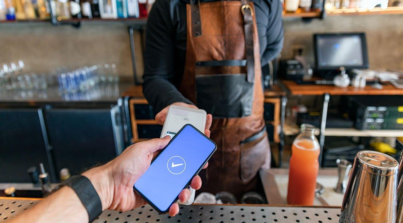 Man using contactless payment at coffee shop
